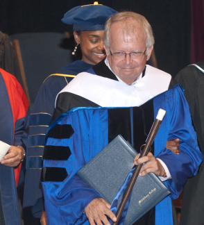 Professor James Maddox receives an honorary degree from Middlebury College's Breadloaf School of English